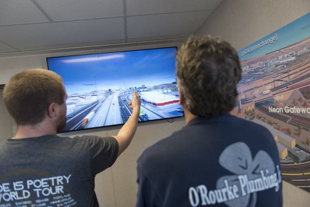 Kenny Eliason, left, and Tim O'Rourke are seen during a Project Neon preview event at the Spaghetti Bowl construction project's trailer at 320 Wall St. in Las Vegas Wednesday, June 15, 2016. Jason ...