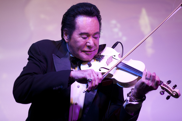 "Wayne Newton plays the violin during his show ""Up Close And Personal"" on Thursday, June 16, 2016 at the Bally's hotel-casino in Las Vegas. Loren Townsley/Las Vegas Review-Journal ..."