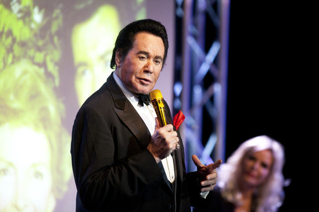 "Wayne Newton, from left, answers questions from the audience as his wife, Kathleen McCrone, listens during his show ""Up Close And Personal"" on Thursday, June 16, 2016 at the Ball ..."
