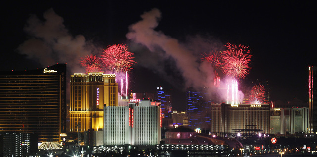Fireworks explode over the Las Vegas strip during the New Year's Eve celebration on Jan. 1, 2014. (Jason Bean/Las Vegas Review-Journal)