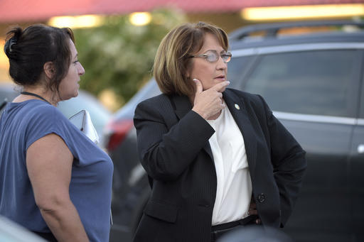 Orange County Mayor Teresa Jacobs, right, is briefed after arriving to the scene of a fatal shooting at Pulse Orlando nightclub in Orlando, Fla., Sunday, June 12, 2016. (Phelan M. Ebenhack/AP Photo)