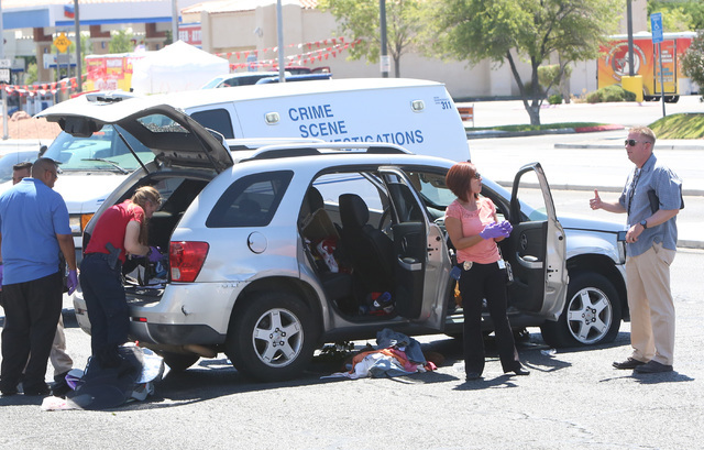 Police inspect the vehicle near Craig Road and Decatur Boulevard after a North Las Vegas police officer was shot at during an investigation on Wednesday, June 29, 2016.  Bizuayehu Tesfaye/Las Vega ...