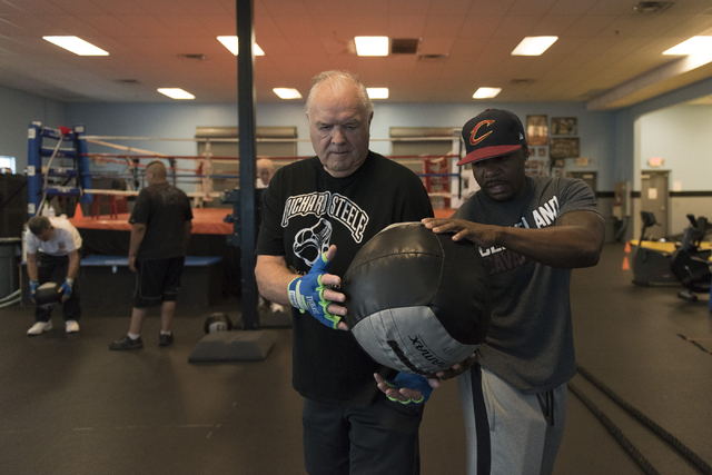 Instructor Donche King, right, and Jerry Sloan do ball exercises during the Rock Steady Boxing Program at Richard Steele Boxing Club in North Las Vegas June 20, 2016. Jason Ogulnik/View