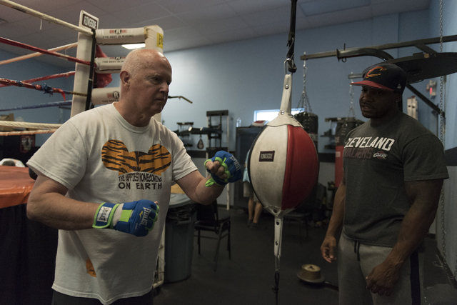 Robert Nicholson, left, punches a speed bag as instructor Donche King gives guidance during the Rock Steady Boxing Program at Richard Steele Boxing Club in North Las Vegas June 20, 2016. Jason Ogu ...