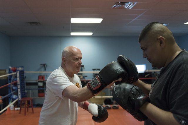 Robert Nicholson, left, does punching exercises with instructor Alvaro Morales during the Rock Steady Boxing Program at Richard Steele Boxing Club in North Las Vegas June 20, 2016. Jason Ogulnik/View