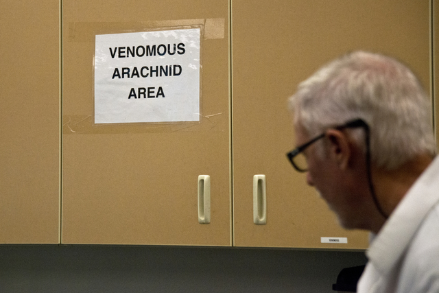 "M.L. Robinson walks by a sign designating a ""Venomous Arachnid Area"" in the University of Nevada Cooperative Extension lab in Las Vegas May 26, 2016. Daniel Clark/View"