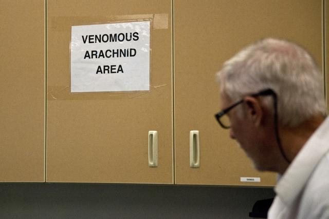 "M.L. Robinson walks by a sign designating a ""Venomous Arachnid Area"" in the University of Nevada Cooperative Extension lab in Las Vegas May 26, 2016. Daniel Clark/View"