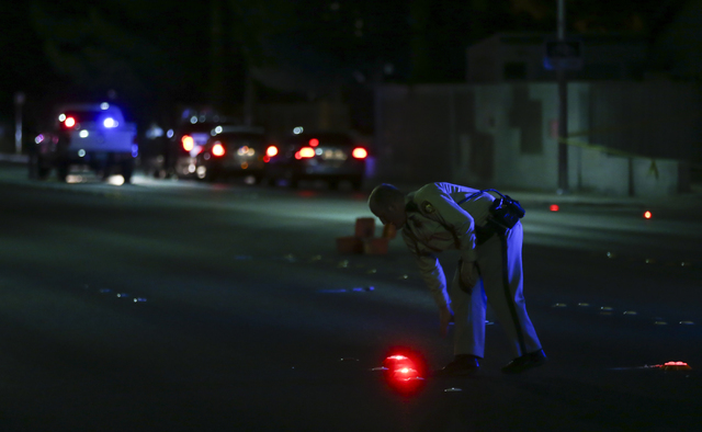 Las Vegas police block off Torrey Pines Drive near Lake Mead Boulevard as a barricade situation goes on in a nearby apartment complex in Las Vegas on Wednesday, June 29, 2016. A homicide occurred  ...