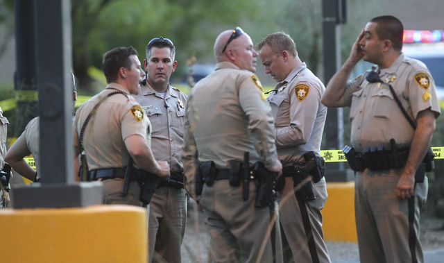 Las Vegas police investigate a homicide outside of a Walgreens at Lake Mead and Jones Boulevards in Las Vegas on Wednesday, June 29, 2016. (Chase Stevens/Las Vegas Review-Journal) Follow @cssteven ...