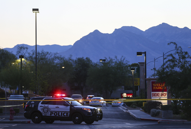 Las Vegas police investigate the homicide of Phoukeo Dej-Oumond, outside a Walgreens at Lake Mead and Jones boulevards in Las Vegas on Wednesday, June 29, 2016. Chase Stevens/Las Vegas Review-Jour ...