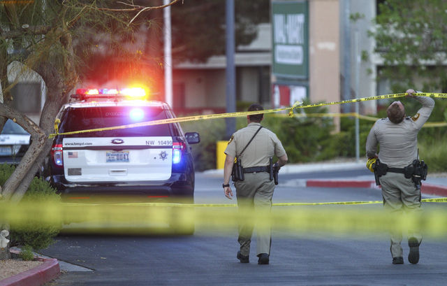 Las Vegas police investigate a homicide outside a Walgreens at Lake Mead and Jones boulevards in Las Vegas on Wednesday, June 29, 2016. Chase Stevens/Las Vegas Review-Journal Follow @csstevensphoto