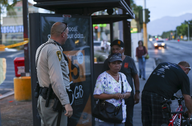 Las Vegas police shut down a sidewalk and bus stop while investigating a homicide outside of a Walgreens at Lake Mead and Jones Boulevards in Las Vegas on Wednesday, June 29, 2016. (Chase Stevens/ ...