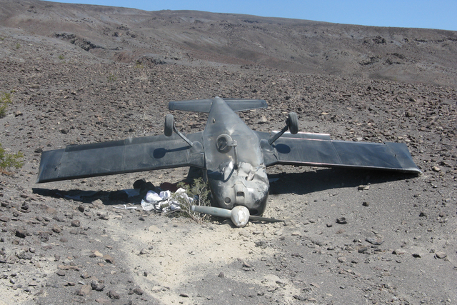 A small airplane rests on its roof where it crashed Sunday while trying to land at a remote airstrip in Death Valley National Park. The two people on board escaped without injury. (Courtesy of the ...