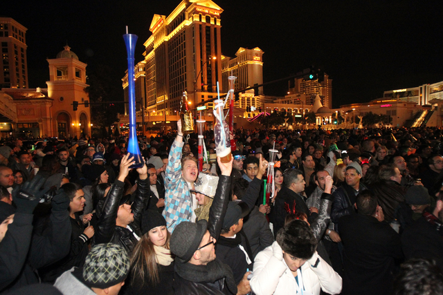 Revelers dance to a DJ in front of Bally's on the Strip in Las Vegas on New Year's Eve Wednesday, Dec. 31, 2014. (K.M. Cannon/Las Vegas Review-Journal)