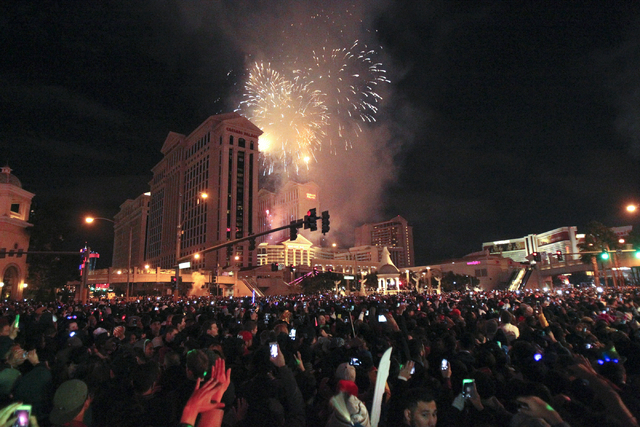 Fireworks explode over Caesars Palace on the Strip in Las Vegas on New Year's Eve Wednesday, Dec. 31, 2014. (K.M. Cannon/Las Vegas Review-Journal)