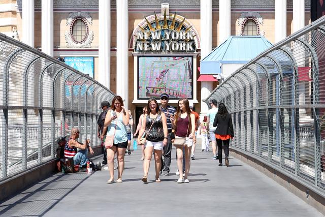 Tourists walk on the pedestrian bridge between New York-New York and the MGM Grand Wednesday, May 11, 2016. (Bizuayehu Tesfaye/Las Vegas Review-Journal Follow @bizutesfaye)