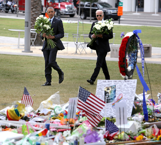 President Barack Obama and Vice President Joe Biden visit a makeshift memorial to the victims of the Pulse nightclub shooting, Thursday, June 16, 2016, in Orlando, Fla.  (Joe Burbank/Orlando Senti ...