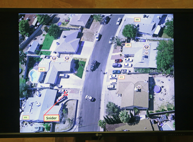 A slide is shown during a police fact finding review at Clark County Government Center Wednesday, June 15, 2016, in Las Vegas. The review covered details of the officer-involved shooting death of  ...