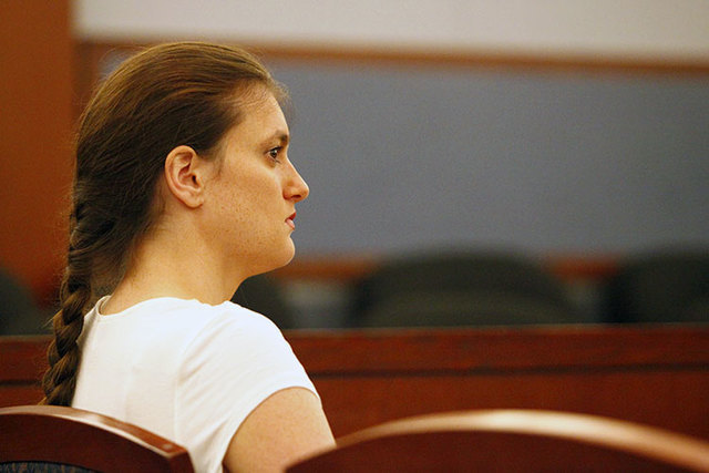 Michelle Flores, who was banned from Las Vegas district libraries for one year for carrying a firearm, appears in district court on Tuesday before Judge Stefany A. Miley, asking for removal of the ...