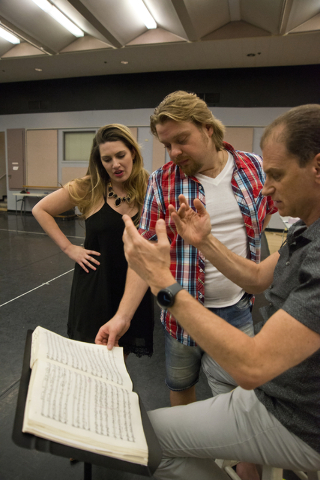 "Soprano Suzanne Vinnik, left, and tenor Viktor Antipenko consult with conductor Gregory Buchalter during a rehearsal for Opera Las Vegas' ""Carmen,"" which opens Friday at UNLV's Judy Bayley Theatre ..."