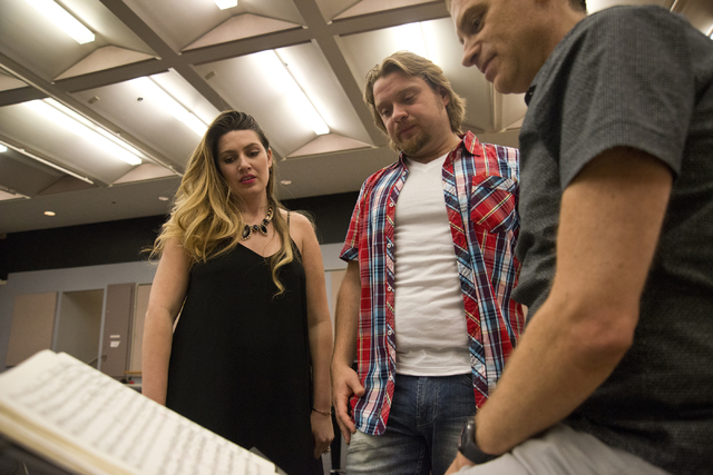 "Performers Suzanne Vinnik, left, and Viktor Antipenko, center, speak with conductor Gregory Buchalter during rehearsals for Opera Las Vegas' production of ""Carmen"" this weekend at UNLV. Daniel Cla ..."