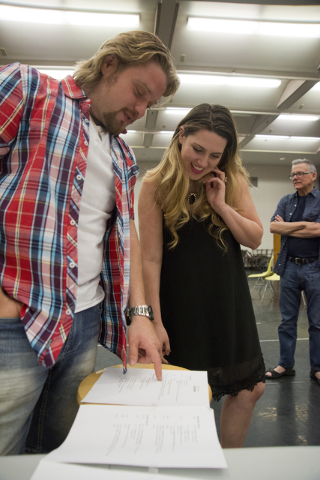 "Singers Suzanne Vinnik and Viktor Antipenko review the rehearsal schedule for Opera Las Vegas' ""Carmen,"" which will be staged Friday and Sunday in UNLV's Judy Bayley Theatre. Daniel Clark/Las Vega ..."