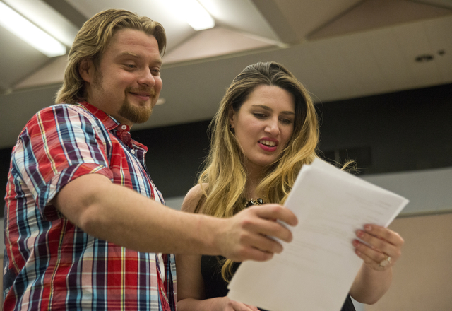 Suzanne Vinnik goes over the rehearsal schedule with Viktor Antipenko during rehearsal inside the Alta Ham Fine Arts building on the UNLV campus in Las Vegas for the upcoming production of &qu ...