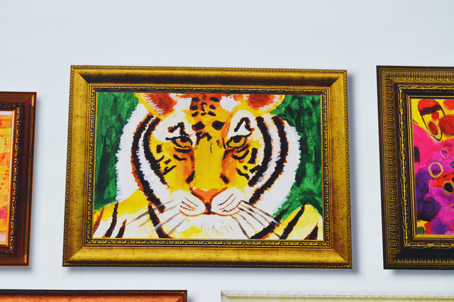 Alyssa T.'s artwork of a tiger is displayed near one of the entrances of Dillard's in Downtown Summerlin in June 2016. Clients from Opportunity Village painted the pieces, which are available for  ...
