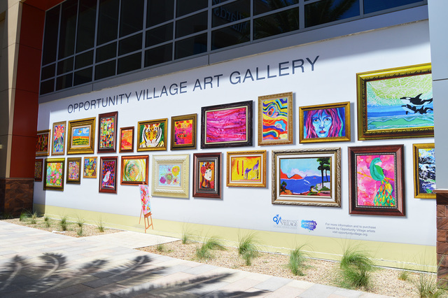 A collection of paintings, near one of the entrances of Dillard's at Downtown Summerlin, were painted by members of Opportunity Village. Melissa Gomez/View