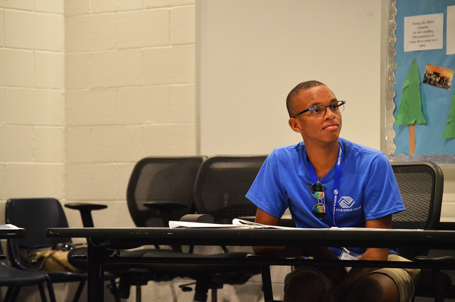 Kendrick Peterson, a graduate of Basic High School, listens in as Mark Jacoby, goes over rules and expectations for staff members of the Boys & Girls Club of Southern Nevada. He is one of five ...
