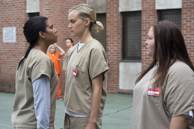 """From left, Jessica Pimentel, Taylor Schilling and Jolene Purdy appear in a scene from the fourth season of Netflix's """"Orange Is the New Black."""" (Courtesy Netflix)"""