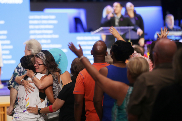 Eileen Vale hugs Beth Case at a service to honor victims of the Orlando nightclub shooting at the First Baptist Orlando Church in Orlando, Florida on Tuesday, June 14, 2016. (Rachel Aston/Las Vega ...