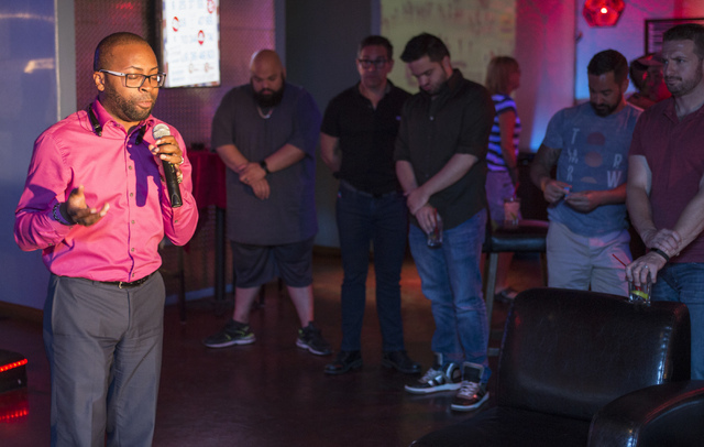 Norman Liverpool ask the crowd for a moment of silence during a fundraiser for the victims of the Pulse nightclub attack in Orlando, Fla., at the Phoenix bar and lounge located at 4213 West Sahara ...