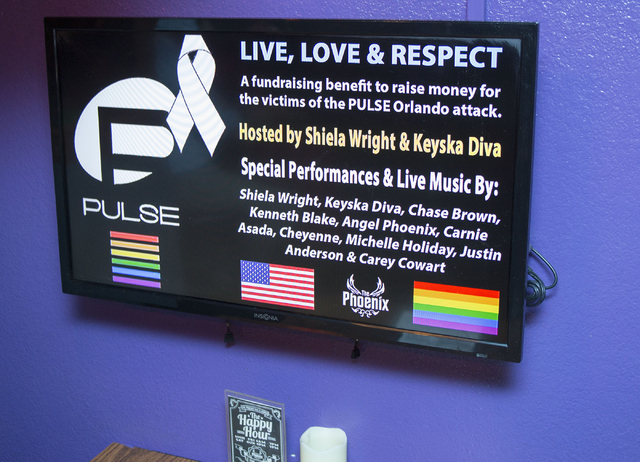 A fundraiser sign for the victims of the Pulse nightclub attack in Orlando, Fla., at the Phoenix bar and lounge located at 4213 West Sahara Avenue in Las Vegas on Tuesday, June 15, 2016. (Richard  ...