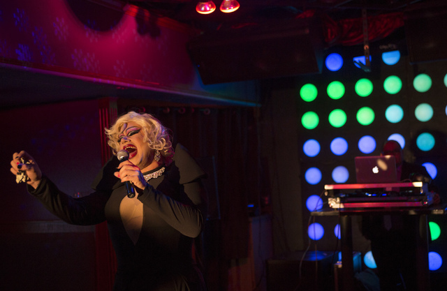 Justin Schindler, dressed in drag, performs during a fundraiser for the victims of the Pulse nightclub attack in Orlando, Fla., at the Phoenix bar and lounge located at 4213 West Sahara Avenue in  ...