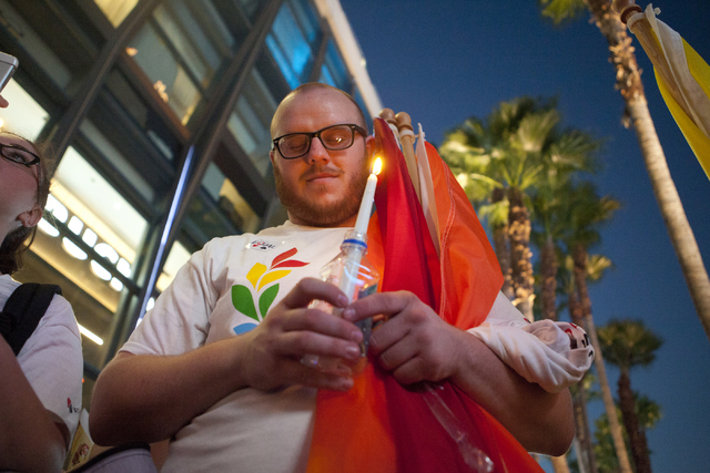 Tyler Doss pays his respects to the victims during a candlelight vigil at The Cosmopolitan of Las Vegas on Monday, June 20, 2016, at the Las Vegas Strip. Loren Townsley/Las Vegas Review-Journal Fo ...