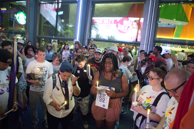 The LGBT community and their allies pay their respects to the victims during a candlelight vigil at The Cosmopolitan of Las Vegas on Monday, June 20, 2016, at the Las Vegas Strip. Loren Townsley/L ...
