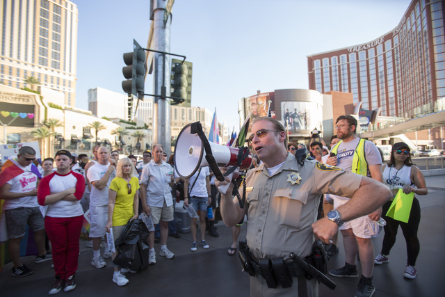 Metro Lieutenant Rick Given speaks to the crowd before a march on the Las Vegas Strip to show solidarity for the victims of the Pulse nightclub shooting in Orlando, Fla., in Las Vegas on Monday, J ...