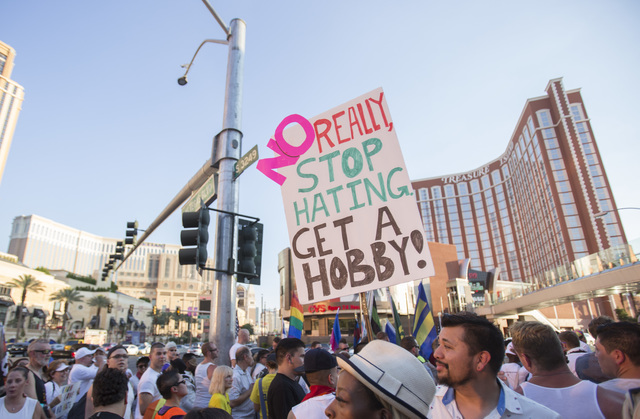 People gather on the Las Vegas Strip to show their solidarity for the victims of the Pulse nightclub shooting in Orlando, Fla., in Las Vegas on Monday, June 20, 2016. Richard Brian/Las Vegas Revie ...