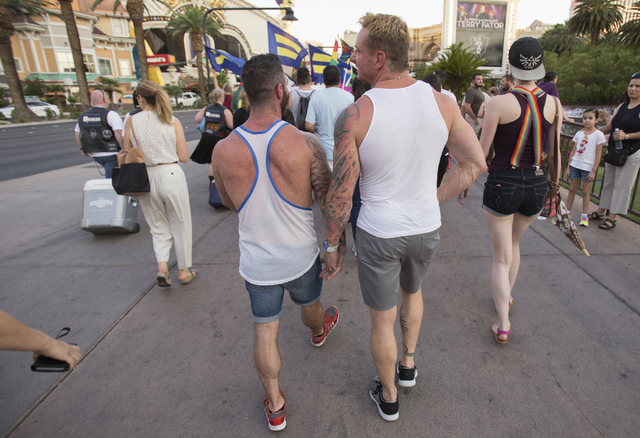 A couple holds hands during a march on the Las Vegas Strip to show solidarity for the victims of the Pulse nightclub shooting in Orlando, Fla., in Las Vegas on Monday, June 20, 2016. Richard Brian ...