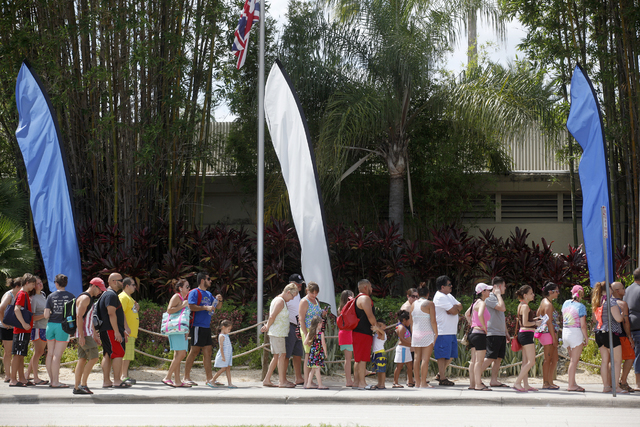 Tourists wait in line at Wet n' Wild, a water theme park, in Orlando, Fla., on Thursday, June 16, 2016.  (Rachel Aston/Las Vegas Review-Journal) Follow @rookie__rae