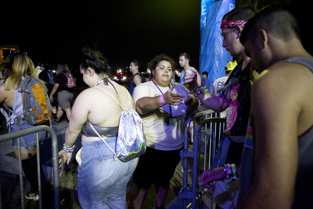 A staff member who declined to give her name checks tickets at the entrance of the Electric Daisy Carnival at the Las Vegas Motor Speedway in North Las Vegas.. (Loren Townsley/Las Vegas Review-Jou ...
