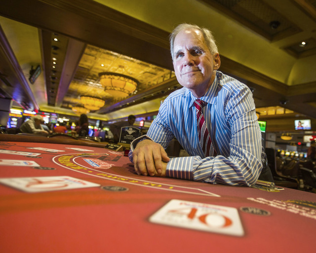 Mike Manning, Santa Fe Station shift manager, 39 years with the company, sits at a blackjack table at Palace Station on Tuesday, June 28, 2016. The Palace Station celebrates its 40th anniversary t ...