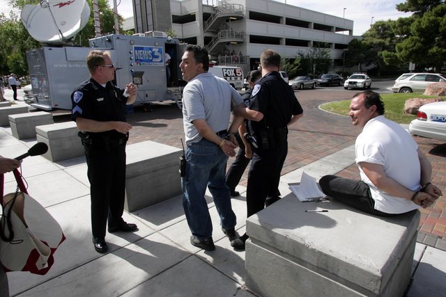 Republican activist Tony Dane, left, and another petition signature gatherer are arrested on the UNLV campus outside a rally attended by First Lady Laura Bush Tuesday, May 18, 2004. (K.M. Cannon/L ...