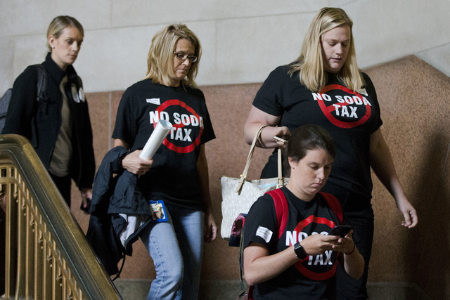 Opponents of a tax on sugary and diet beverages depart City Hall after City Council passed the tax, in Philadelphia on June 16, 2016. Philadelphia has become the first major American city with a s ...