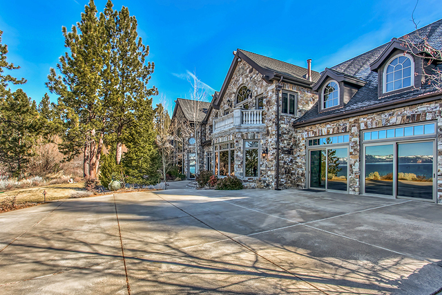 Located in Zephyr Cove, this Lake Tahoe equestrian property has a 378-foot stretch of sandy beach and pier with boat hoist, 13-acre irrigated meadow for horses and a 16,703-square-foot main house. ...