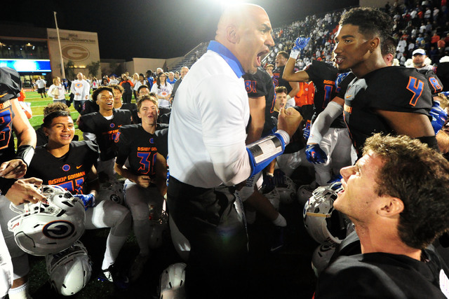 Bishop Gorman head coach Kenny Sanchez and players celebrate their 30-16 win over Don Bosco Prep after their prep football game at Bishop Gorman High School in Las Vegas Friday Oct. 23, 2015. (Jos ...