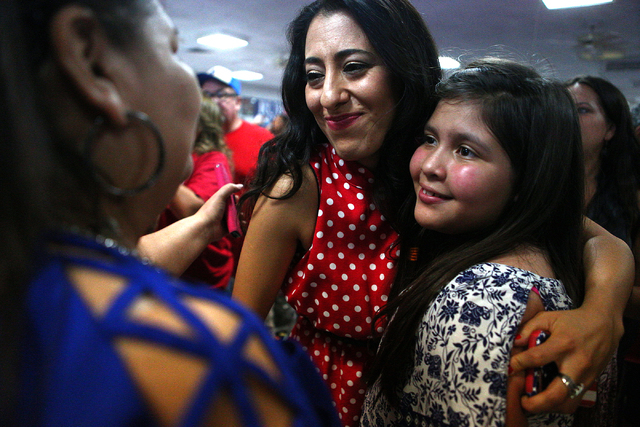Mariana Kihuen, sister of Democratic Congressional District 4 candidate Ruben Kihuen celebrates with supporters during election night watch party at Culinary Workers Union Local 226 in Las Vegas o ...