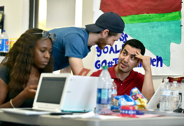 Democratic congressional candidate Ruben Kihuen, right, works with volunteer Avyon Pearson, left, and his deputy finance director Sam Rivers at a campaign office Tuesday, June 14, 2016, in Las Veg ...