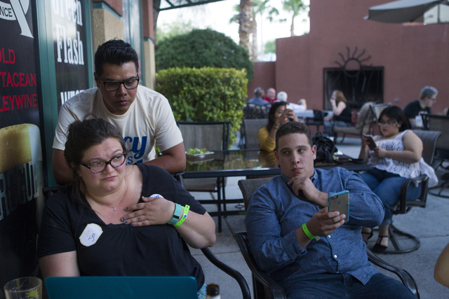 Staff members including campaign manager Antonio Valdovinos, right, react as early results show Democratic Congressional District 4 candidate Lucy Flores trailing in second place behind Ruben Kihu ...